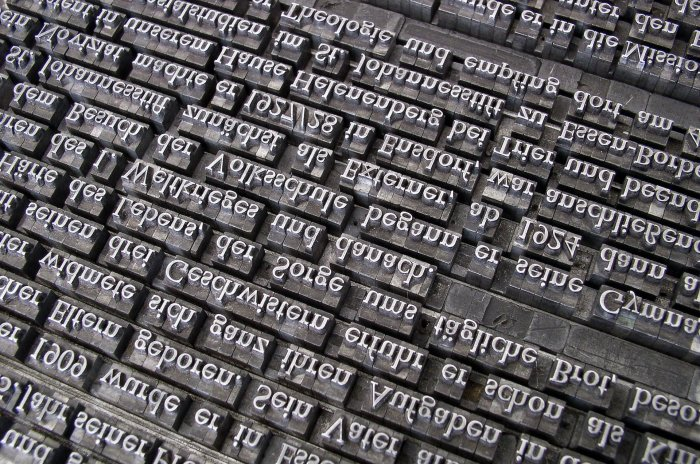 Black and white photo of typeface ready to go to print.